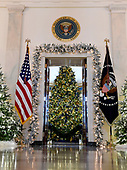 "The 2017 White House Christmas decorations, with the theme ""Time-Honored Traditions,"" which were personally selected by first lady Melania Trump, are previewed for the press in Washington, DC on Monday, November 27, 2017.  Pictured is the Christmas tree in the Blue Room looking through the door from the Grand Foyer.<br /> Credit: Ron Sachs / CNP"
