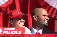 Albert Pujols (5) of the Los Angeles Angels and son Albert jr. at press conference introducing him as a new member of the Angels at Angel Stadium on December 10, 2011 in Anaheim,California.(Larry Goren/Four Seam Images)