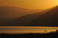 Fishermen at Lake Prespa in sunrise. Lake Prespa National Park, Albania June 2009