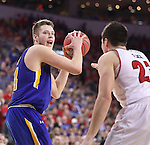 SIOUX FALLS, SD: MARCH 6: Mike Daum #24 of South Dakota State looks past South Dakota defender Tyler Flack #23 during the Summit League Basketball Championship on March 6, 2017 at the Denny Sanford Premier Center in Sioux Falls, SD. (Photo by Dick Carlson/Inertia)