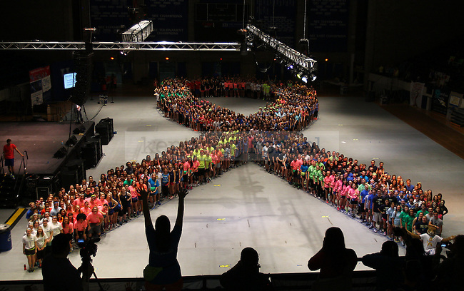 Dancers pose in the shape of a ribbon at DanceBlue 2013 at Memorial Coliseum in Lexington , Ky., on Friday, February 22, 2013. Photo by Michael Reaves | Staff