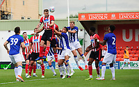 Lincoln City's Michael O'Connor beats Sheffield Wednesday's Joey Pelupessy, centre, and Sheffield Wednesday's Tom Lees to a high ball<br /> <br /> Photographer Chris Vaughan/CameraSport<br /> <br /> Football Pre-Season Friendly - Lincoln City v Sheffield Wednesday - Saturday July 13th 2019 - Sincil Bank - Lincoln<br /> <br /> World Copyright © 2019 CameraSport. All rights reserved. 43 Linden Ave. Countesthorpe. Leicester. England. LE8 5PG - Tel: +44 (0) 116 277 4147 - admin@camerasport.com - www.camerasport.com