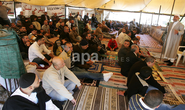 Palestinians attend Friday prayers at the protest tent in the Silwan neighborhood in East Jerusalem on Nov. 11,2011 as Palestinian protesters gather for a demonstration. Photo by Mahfouz Abu Turk