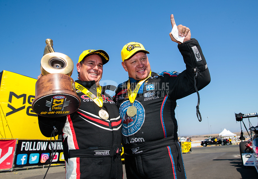 Jul 28, 2019; Sonoma, CA, USA; NHRA top fuel driver Billy Torrence (left) and funny car driver Robert Hight celebrate after winning the Sonoma Nationals at Sonoma Raceway. Mandatory Credit: Mark J. Rebilas-USA TODAY Sports