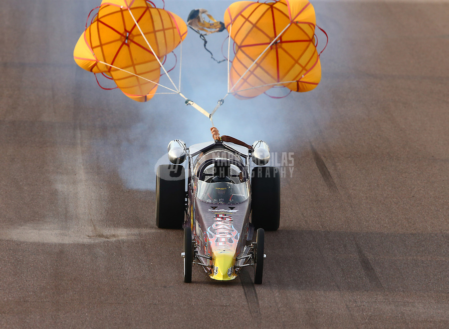 Feb 21, 2015; Chandler, AZ, USA; A jet dragster deploys his parachutes after crossing the finish line following NHRA qualifying for the Carquest Nationals at Wild Horse Pass Motorsports Park. Mandatory Credit: Mark J. Rebilas-