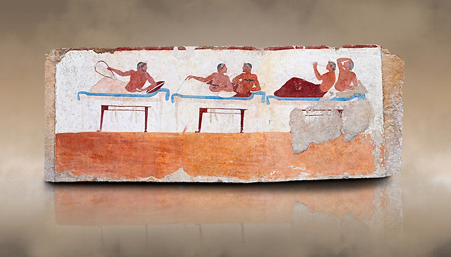 "Greek Fresco on the inside of Tomb of  the Diver  [La Tomba del Truffatore] from the Greek city of Poseidonia which became Roman Paestum. This panel is from one of the long sides of the tomb and shows a symposium of men lying on couches facing low tables.  The men on the couches are playing the song of Eros the liar and the flute to distract the deceased from worldly thoughts so he can enter the next world. The tomb is painted with the true fresco technique and its importance lies in being ""the only example of Greek painting with figured scenes dating from the Orientalizing, Archaic, or Classical periods to survive in its entirety. Paestrum, Andriuolo.  (480-470 BC  )"