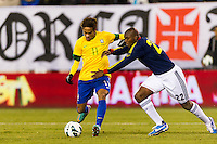 Neymar (11) of Brazil beats Aquivaldo Mosquera (22) of Colombia to score a goal. Brazil (BRA) and Colombia (COL) played to a 1-1 tie during international friendly at MetLife Stadium in East Rutherford, NJ, on November 14, 2012.