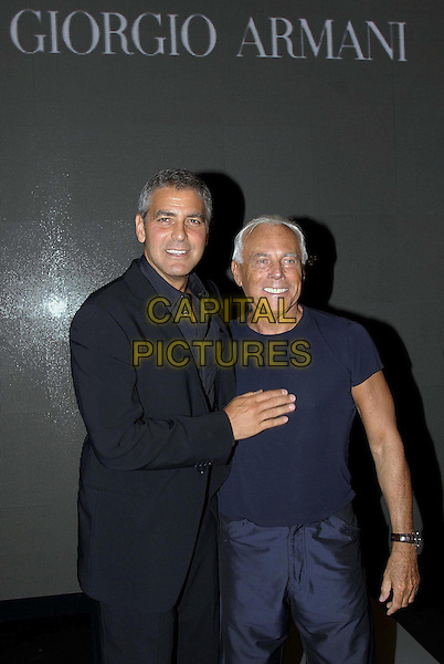 GEORGE CLOONEY & GIORGIO ARMANI.Armani's Spring-Summer 2007 men's collection, during Milan's fashion shows, Milan, Italy..June 28th, 2006 .Ref: OME.half length black suit jacket blue tee shirt.www.capitalpictures.com.sales@capitalpictures.com.© Capital Pictures.