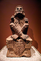Sculpture of Xocchipilli, the Aztec god of music, song, flowers and love in the Sala Mexica, National Museum of Anthropology, Chapultec Park, Mexico City