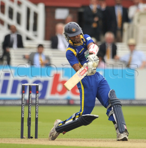 03.07.2011. Lords, London England.  Cricket ODI International from Lords. England versus  Sri Lanka. England scored 246. Chandimal hits the runs to bring up his 100