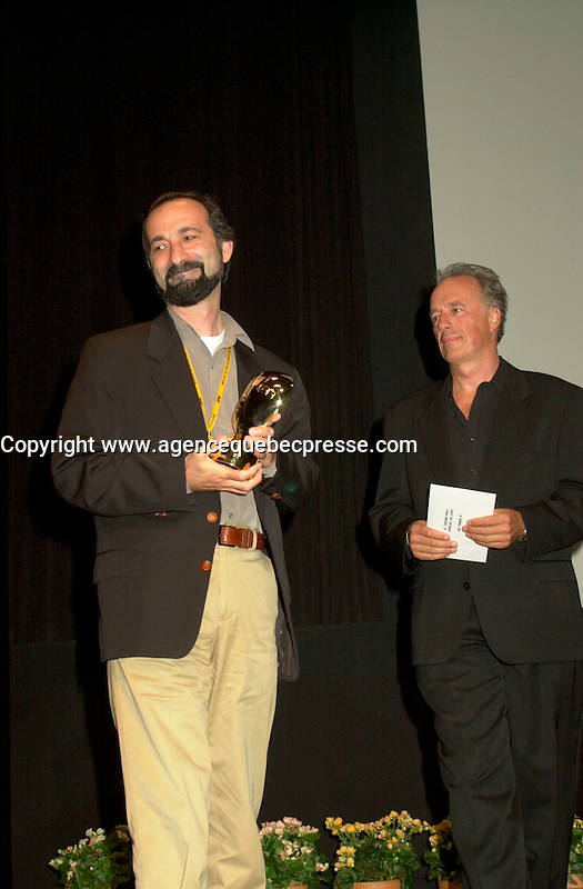 Sept 2, 2002, Montreal, Quebec, Canada<br /> <br /> Tayfun Pirselomoglu (Left) receive a Special Grand Prix of the Jury  for his film HICBIRYEDE (INNOWHERE LAND),at the closing ceremony of the 2002 Montreal World Films Festival, Sept 2 2002, in  Montreal, Quebec, Canada<br /> <br /> <br /> Mandatory Credit: Photo by Pierre Roussel- Images Distribution. (&copy;) Copyright 2002 by Pierre Roussel <br /> <br /> NOTE : <br />  Nikon D-1 jpeg opened with Qimage icc profile, saved in Adobe 1998 RGB<br /> .Uncompressed  Uncropped  Original  size  file availble on request.