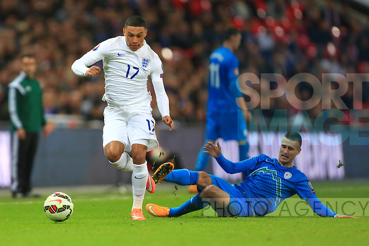 Alex Oxlade-Chamberlain of England skips past a tackle from Andraz Struna of Slovenia - England vs. Slovenia - UEFA Euro 2016 Qualifying - Wembley Stadium - London - 15/11/2014 Pic Philip Oldham/Sportimage