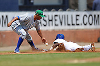 Lexington Legends third baseman Michael Antonio #16 attempts to apply a tag as Juan Ciriaco #2 slides in safely during a game against the Asheville Tourists at McCormick Field on June 16, 2013 in Asheville, North Carolina. The Tourists won the game 8-7. (Tony Farlow/Four Seam Images)