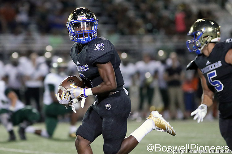 Boswell's Breshun Berry returns an interception 43 yards for the touchdown in the third quarter during their win over Birdville 37-35 in high school football at Pioneer Stadium in Fort Worth on Friday, September 15, 2017. (photo by Khampha Bouaphanh)