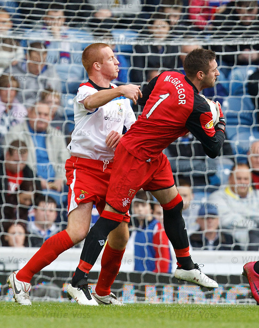 Adam Rooney barges into Allan McGregor