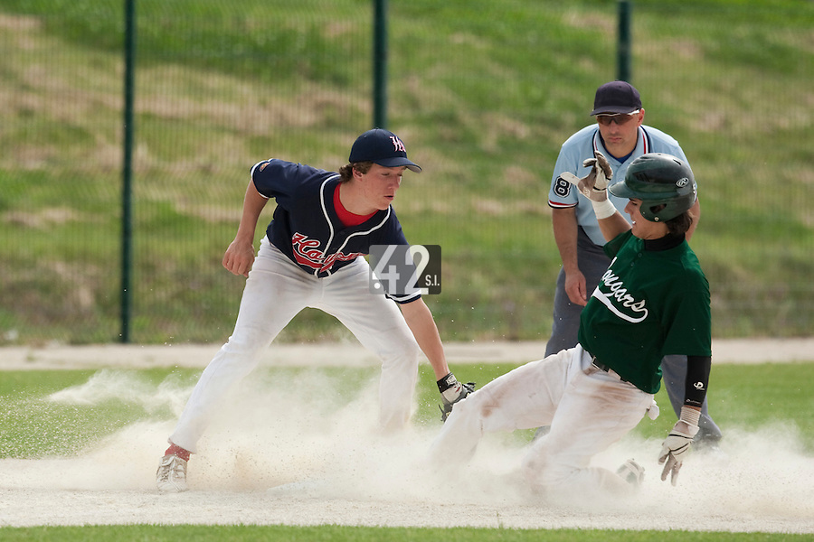 22 May 2009: Maxime Lefevre of Montigny slides safely as Romain Leduc of La Guerche tags him during the 2009 challenge de France, a tournament with the best French baseball teams - all eight elite league clubs - to determine a spot in the European Cup next year, at Montpellier, France.
