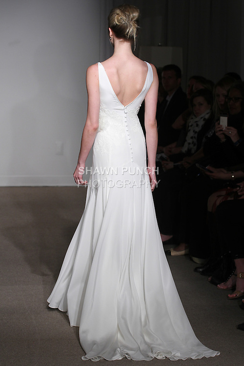 """Model walks runway in a Lara bridal gown from the Anna Maier Couture Spring 2016 """"Collection 43"""" during New York Bridal Fashion Week Spring 2016."""