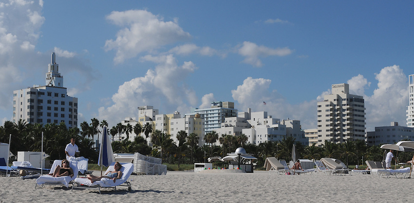 Elegant women basking in the afternoon sun at beautiful South Beach, Miami Beach Florida.