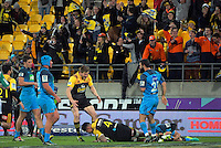 Fans celebrate Vaea Fifita's second try during the Super Rugby match between the Hurricanes and Blues at Westpac Stadium, Wellington, New Zealand on Saturday, 2 July 2016. Photo: Dave Lintott / lintottphoto.co.nz