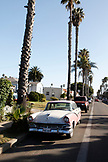 USA, California, San Diego, new and old cars line the road leading to Ocean Beach