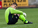 Dejected Queens Park goalie William Muir at the end of the game.