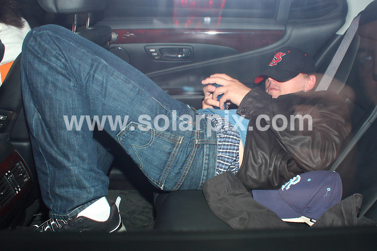 **ALL ROUND PICTURES FROM SOLARPIX.COM**.**WORLDWIDE SYNDICATION RIGHTS**.**NO PUBLICATION IN AUSTRALIA, DENMARK, GERMANY, NEW ZEALAND, RUSSIA, UK OR USA**.The Hollywood star Leonardo Di Caprio seen slumped in the backseat of a friends car after a long night of drinking last night at Villa Lounge in West Hollywood los Angeles California in the USA..?JOB REF:7151-LAP/HD       DATE: 28_08_08.**MUST CREDIT SOLARPIX.COM OR DOUBLE FEE WILL BE CHARGED* *UNDER NO CIRCUMSTANCES IS THIS IMAGE TO BE REPRODUCED FOR ANY ONLINE EDITION WITHOUT PRIOR PERMISSION*