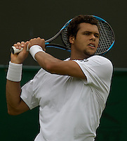 Jo-Wilfried Tsonga (FRA) (9) against Andrey Golubev (KAZ) in the first round of the Gentlemen's Singles. Tsonga beat Golubev 6-3 5-7 7-6 7-6 ..Tennis - Wimbledon - Day 9 - Wed 1st July 2009 - All England Lawn Tennis Club  - Wimbledon - London - United Kingdom..Frey Images, Barry House, 20-22 Worple Road, London, SW19 4DH.Tel - +44 20 8947 0100.Cell - +44 7843 383 012