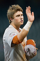 Kacy Clemens #42 of the Texas Longhorns high fives a teammate between innings of the game against the Sam Houston State Bearkats at Minute Maid Park on March 2, 2014 in Houston, Texas.  The Longhorns defeated the Bearkats 3-2 to finish the tournament 3-0.  (Brian Westerholt/Four Seam Images)