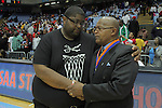Winston-Salem Prep head coach Andre Gould, left, shares a moment with Plymouth coach Marvin Davenport after Winston-Salem Prep won the State Championship against Plymouth at the Dean Smith Center in Chapel Hill, NC, on Saturday, March 10, 2012.  Photo by Ted Richardson