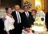 President George W. Bush and Laura Bush pose with former President Gerald R. Ford and wife Betty Ford during the presentation of the birthday cake at the Dinner in Honor of President Ford's 90th Birthday at the White House, Wednesday, July 16, 2003.  <br /> Mandatory Credit: Eric Draper / White House via CNP