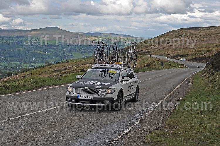 PRO team cyclists near the top of the challenging iconic and notorious 6km 10% stretch of road namely The Tumble during the Wales Velothon 2016 140km route cycling race.Control cars on the course.<br />