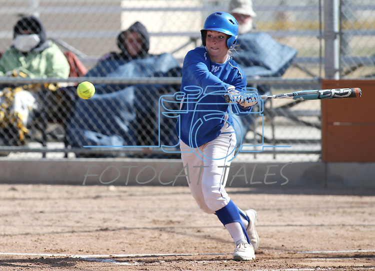 Western Nevada's Jennie Quam slaps in a college softball game against College of Southern Idaho in Carson City, Nev., on Friday, March 22, 2013..Photo by Cathleen Allison