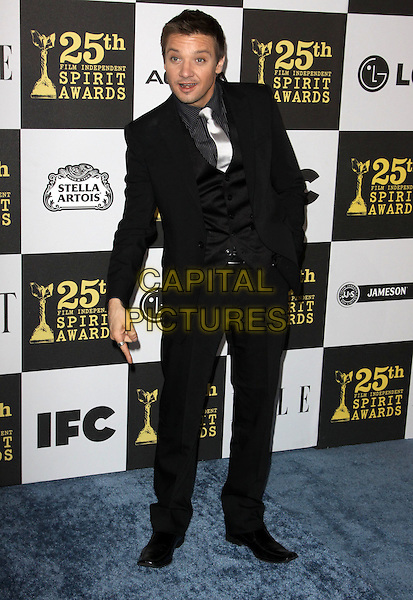 JEREMEY RENNER .25th Annual Film Independent Spirit Awards held At The Nokia LA Live, Los Angeles, California, USA,.March 5th, 2010 ..arrivals Indie Spirit full length black suit tie waistcoat white silver hand in pocket mouth open funny .CAP/ADM/KB.©Kevan Brooks/Admedia/Capital Pictures