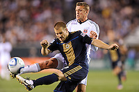 Jordan Harvey (2) of the Philadelphia Union clears the ball away from Adam Cristman (7) of D. C. United during the second half. The Philadelphia Union defeated D. C. United 3-2 during a Major League Soccer (MLS) match at Lincoln Financial Field in Philadelphia, PA, on April 10, 2010.