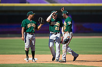 (L-R) Sicnarf Loopstok (43), Clint Frazier (20) and LeVon Washington (8) celebrate their win over the Winston-Salem Dash at BB&T Ballpark on August 2, 2015 in Winston-Salem, North Carolina.  The Hillcats defeated the Dash 8-3.  (Brian Westerholt/Four Seam Images)