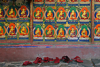 The Monks boots or shoes outside the temple, leaving the boots outside during prayers, wall paintings of Buddha