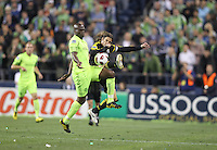 Blaise Nkufo (9)of the Seattle Sounders FC tackles Frankie Hejduk (2) of the Columbus Crew. The Seattle Sounders FC defeated the Columbus Crew 2-1 during the US Open Cup Final at Qwest Field in Seattle,WA, on October 5, 2010.