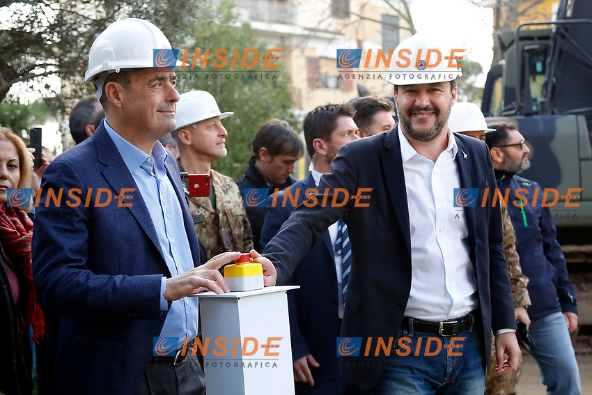 Nicola Zingaretti, President of Lazio Region and Matteo Salvini, minister of Internal Affairs pushing a red button button to start de demolition<br /> Nicola Zingaretti e Matteo Salvini spingono il bottone che dara' il via alle operazioni di demolizione<br /> Roma 26/11/2018. Demolizione di una villa del clan malavitoso della famiglia Casamonica alla Romanina, Roma est. I Casamonica sono associati al crimine nella periferia sud est di Roma.<br /> Rome November 26th 2018. Another Casamonica mobster clan villa being demolished. Army started the demolition of an illegally built villa belonging to members of the Casamonica criminal clan.  The Casamonica family has been associated with crime in the south-eastern quarters of Rome for several decades.<br /> Foto Samantha Zucchi Insidefoto