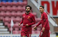 Mohamed Salah (left) & Roberto Firmino of Liverpool warm up ahead of the pre season friendly match between Wigan Athletic and Liverpool at the DW Stadium, Wigan, England on 14 July 2017. Photo by Andy Rowland.