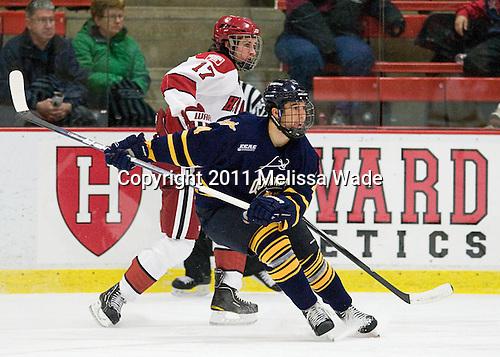 Rence Coassin (Harvard - 17), Loren Barron (Quinnipiac - 4) - The Harvard University Crimson and Quinnipiac University Bobcats played to a 2-2 tie on Saturday, November 5, 2011, at Bright Hockey Center in Cambridge, Massachusetts.