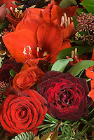 Close up of a bouquet of roses and red lillies