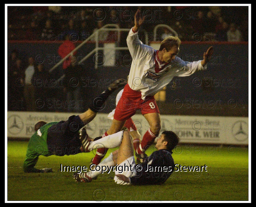 17/11/2001                 Copyright Pic : James Stewart .Ref : DSC_3391                          .File Name : stewart08-falkirk v airdrie.AIRDRIE KEEPER ALAN FERGUSON SAVES FROM STEVEN CRAIG AS NEAL MCFARLANE ASSISTS......James Stewart Photo Agency, Stewart House, Stewart Road, Falkirk. FK2 7AS      Vat Reg No. 607 6932 25.Office     : +44 (0)1324 630007     .Mobile  : + 44 (0)7721 416997.Fax         :  +44 (0)1324 630007.E-mail  :  jim@jspa.co.uk.If you require further information then contact Jim Stewart on any of the numbers above.........