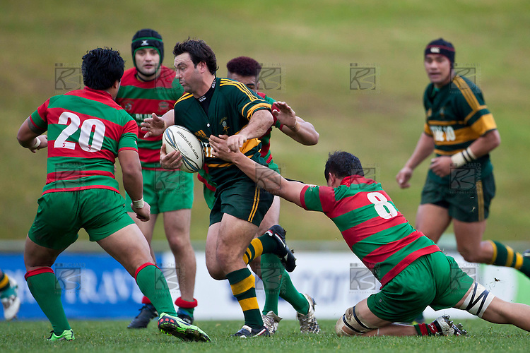 Armyn Sanders gets surrounded by Waiuku defenders as he tries to make a break through the midfield. Counties Manukau McNamara Cup Premier Club Rugby final between Pukekohe andWaiuku, held at Bayer Growers Stadium, on Saturday July 17th. Waiuku won 25 - 20.