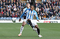 Huddersfield Town's Rajiv van La Parra shields the ball from Burnley's Matthew Lowton<br /> <br /> Photographer Rich Linley/CameraSport<br /> <br /> The Premier League - Burnley v Huddersfield Town - Saturday 6th October 2018 - Turf Moor - Burnley<br /> <br /> World Copyright &copy; 2018 CameraSport. All rights reserved. 43 Linden Ave. Countesthorpe. Leicester. England. LE8 5PG - Tel: +44 (0) 116 277 4147 - admin@camerasport.com - www.camerasport.com