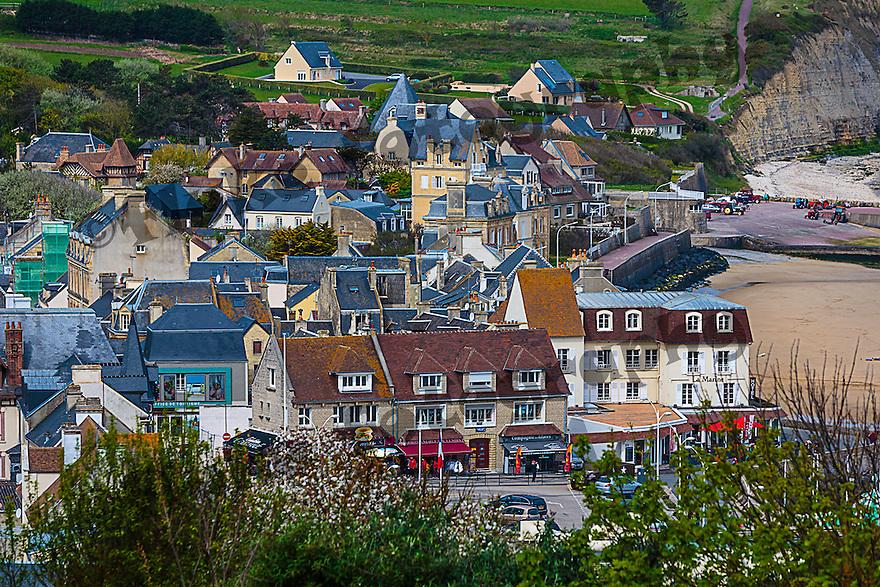 The city of Arromanches, Normandy, France on a bewutiful day .  A quaint village where D-Day took place.  It was hard to imagine that such a horrific time could be remembered at such a place as this.