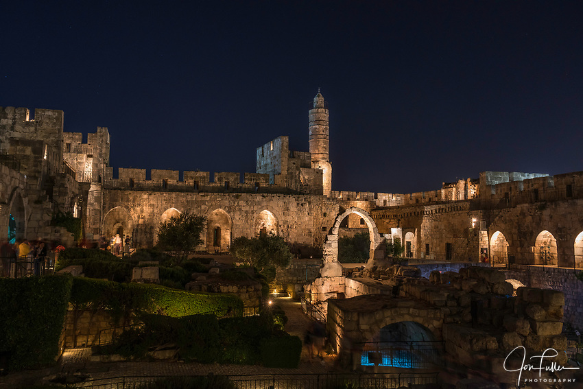 Dusk at the Tower of David or the Citadel in the Armenian Quarter of the Old City of Jerusalem.  In the center is the minaret.  The Old City of Jerusalem and its Walls is a UNESCO World Heritage Site
