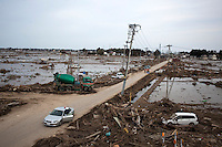 Rescue teams clear roads and search for bodies amongst the debris. On 11 March 2011 a magnitude 9 earthquake struck 130 km off the coast of Northern Japan causing a massive Tsunami that swept across the coast of Northern Honshu. The earthquake and tsunami caused extensive damage and loss of life.