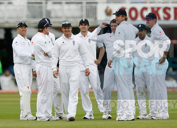 England's players are all smiles as Graham Onions takes his third wicket in an over