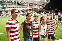Fans pose with Shannon Boxx (7), Heather Mitts (2), and Heather O?Reilly (9) of the United States (USA) after the match. The United States (USA) women defeated China PR (CHN) 4-1 during an international friendly at PPL Park in Chester, PA, on May 27, 2012.