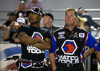 Apr. 5, 2013; Las Vegas, NV, USA: NHRA top fuel dragster driver Antron Brown (left) with crew chief Mark Oswald during qualifying for the Summitracing.com Nationals at the Strip at Las Vegas Motor Speedway. Mandatory Credit: Mark J. Rebilas-